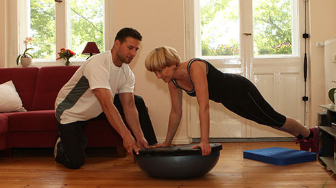 Cost benefit of using a personal trainer versus buying a gym